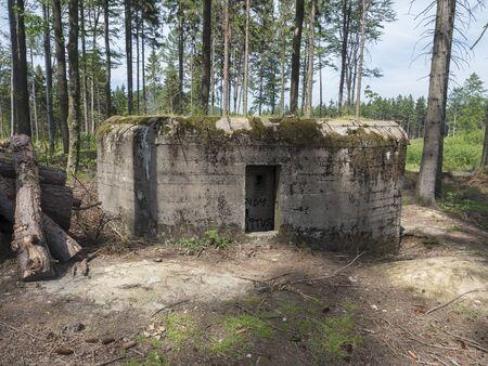 Abandoned World War Two concrete bunker Ropik in spruce tree forest in lusitian mountains near Czech Republic Germany borders