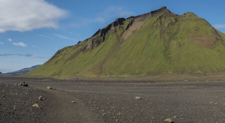 Panoramic view on green Hattafell mountain in Volcanic landscape behind Emstrur camping site on Laugavegur trek in area of Fjallabak Nature Reserve in Highlands region of Iceland