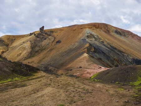 Colorful Brennisteinsalda mountain is one of the most beautiful and multicolored volcanos in Landmannalaugar area of Fjallabak Nature Reserve in Highlands region of Iceland Imagens