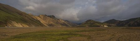 Beautiful scenic panorama of colorful volcanic mountains in Landmannalaugar camp site area of Fjallabak Nature Reserve in Highlands region of Iceland