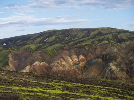 Colorful Rhyolit mountain panorma with multicolored volcanos in Landmannalaugar area of Fjallabak Nature Reserve in Highlands region of Iceland.
