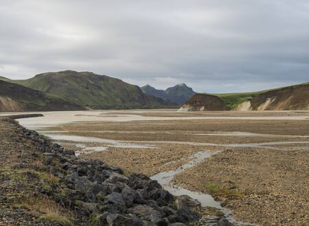 Beautiful scenic panorama of colorful volcanic mountains in Landmannalaugar camp site area of Fjallabak Nature Reserve in Highlands region of Iceland. Imagens