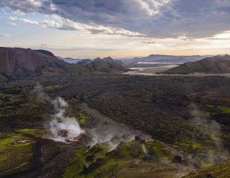 Colorful Rhyolit mountain panorma with multicolored volcanos and geothermal fumarole and river delta. Sunrise in Landmannalaugar at Fjallabak Nature Reserve, Highlands Iceland Reklamní fotografie