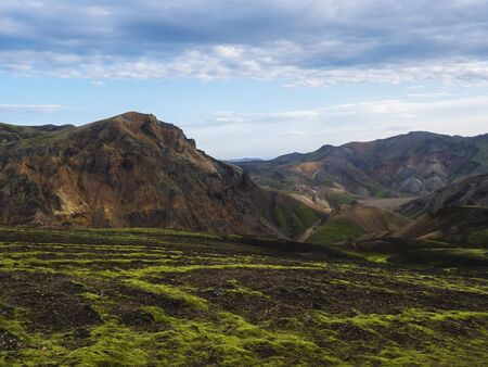 Colorful Rhyolit mountain panorma with multicolored volcanos in Landmannalaugar area of Fjallabak Nature Reserve in Highlands region of Iceland