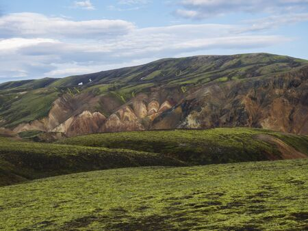 Green meadow with Colorful Rhyolit mountain panorma with multicolored volcanos in Landmannalaugar area of Fjallabak Nature Reserve in Highlands region of Iceland Reklamní fotografie