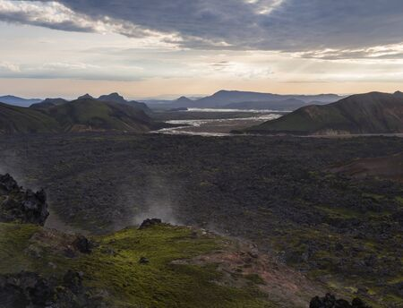 Lava field landscape in Landmannalaugar with and geothermal fumarole, river delta and Rhyolit mountain at Sunrise in Fjallabak Nature Reserve, Highlands Iceland Imagens