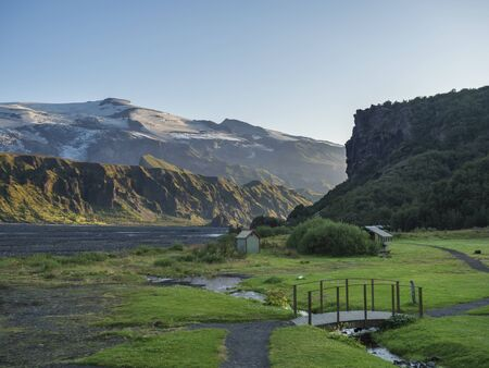 Langidalur camping site in Thorsmork with view on Godaland and Eyjafjallajokull glacier volcano and river Krossa. Highlands of Iceland, end of the Laugavegur hiking trail. Summer Golden hour.