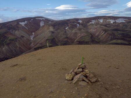 View from top of Brennisteinsalda mountain peak on scenic panorama of colorful volcanic Landmannalaugar mountains. Area of Fjallabak Nature Reserve in Highlands of Iceland Imagens