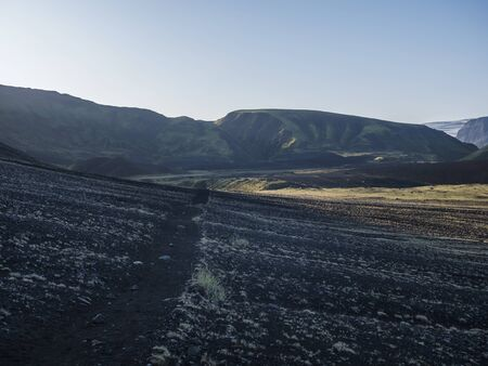 Sunrise view on Myrdalsjokull glacier at Iceland from Laugavegur hiking trail, green valley in volcanic landscape with Early morning pink light