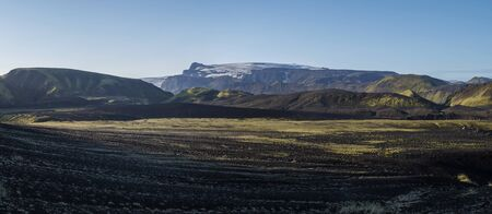 Panoramic sunrise view on Myrdalsjokull glacier. from Botnar campsite at Iceland on Laugavegur hiking trail, green valley in volcanic landscape with Early morning pink light Stok Fotoğraf