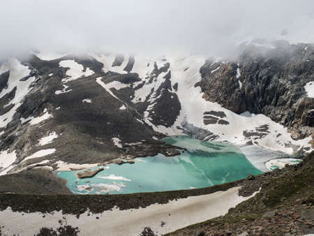 summer view of the Sulzenauferner Glacier and turquoise glacial lake and waterfall from melting ice. Stubai Alps, Austria Zdjęcie Seryjne