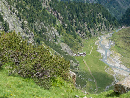 Summer view of winding Sulzenau spring Sulzenaubach and Sulzenaualm hut, Alpine mountain valley in Stubai Austrian Alps Zdjęcie Seryjne