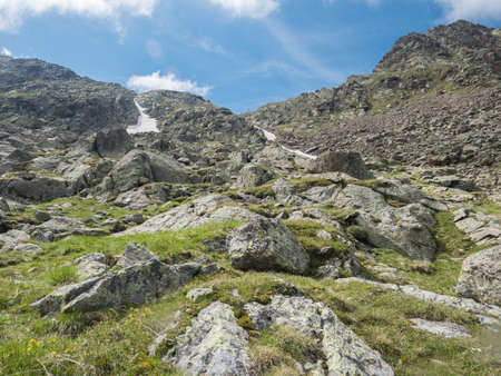 view on slope of mountain peak ridge at Niederl saddle at Stubai hiking trail, Stubai Hohenweg, Summer rocky alpine landscape of Tyrol, Stubai Alps, Austria Zdjęcie Seryjne