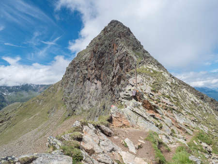 mountain peak ridge at Niederl saddle at Stubai hiking trail, Stubai Hohenweg, Summer rocky alpine landscape of Tyrol, Stubai Alps, Austria