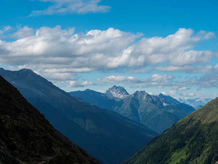 view from Nurnberger Hutte mountain hut at valley with sharp mountain peaks at Stubai hiking trail, Stubai Hohenweg, Summer rocky alpine landscape of Tyrol, Stubai Alps, Austria