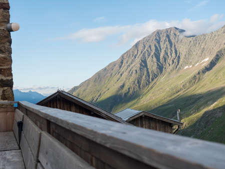 view from terrace of Nurnberger Hutte mountain hut at valley with sharp mountain peaks at Stubai hiking trail, Stubai Hohenweg, Summer rocky alpine landscape of Tyrol, Stubai Alps, Austria.