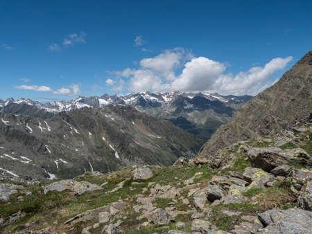 view of mountain and snow-capped peaks at Stubai hiking trail, Stubai Hohenweg, Summer rocky alpine landscape of Tyrol, Stubai Alps, Austria