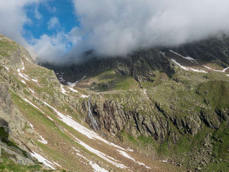view of wild river, waterfall from melting ice at hiking trail, Stubai Hohenweg Tyrol, Austrian Alps