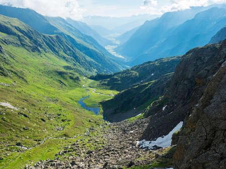 Beutiful green summer alpine mountain valley with winding river spring stream. Stubai hiking trail, Stubai Hohenweg at Tyrol, Austrian Alps Archivio Fotografico