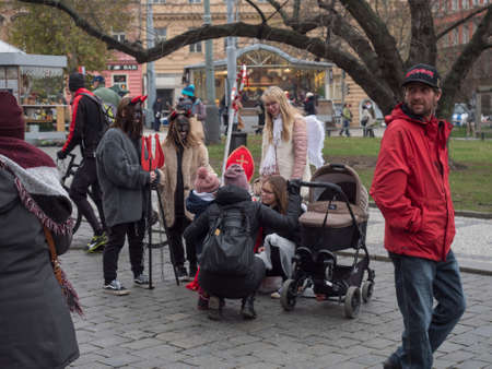 CZECH REPUBLIC, Prague, December 5, 2019: Traditional Christmas Market at Namesti Miru square with stalls selling homemade gifts, food,decorations and toys. People shopping and having a good time Editoriali