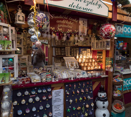CZECH REPUBLIC, Prague, December 5, 2019: Traditional Christmas Market stall at Namesti Miru square selling homemade gifts, souvenirs, christmas decorations and toys. Editoriali