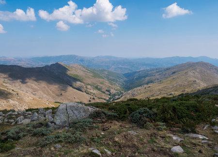 Mountain landscape in Gennargentu, highest mountain in Sardinia, Nuoro, Italy. Vaste peaks, dry plains and valleys with mediterranean vegetation. Late summer, blue sky