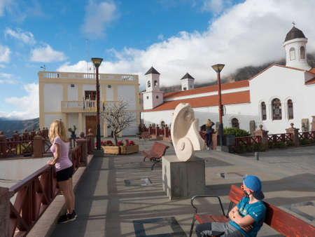 Tejeda, Gran Canaria, Canary Islands, Spain December 15, 2020: Main street in Tejeda with church Nuestra Senora del Socorro and town hall. Picturesque Canarian village at inland mountain valley