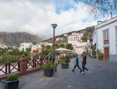 Tejeda, Gran Canaria, Canary Islands, Spain December 15, 2020: Main street in Tejeda. Picturesque Canarian village at inland mountain valley on sunny day