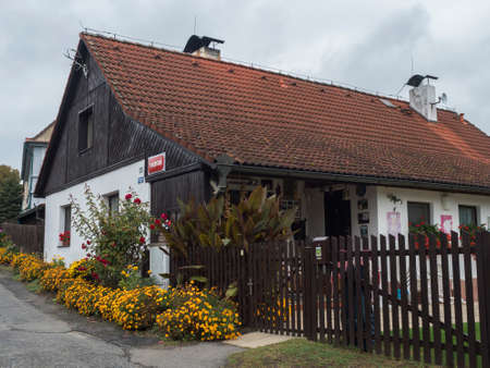 Czech Republic, Blatce, September 27, 2020: view of rustic country house, cottage U Halbychu, sport club of bikers in small village at Kokorinsko nature park