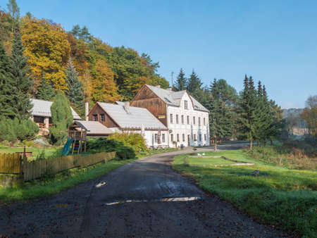 Czech Republic, Houska, October 25, 2020: View of pension called Hostinec pod Houskou, old country guest house near gotthic castle Houska. Sunny Autumn day Editöryel