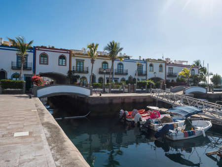 Puerto de Mogan, Gran Canaria, Canary Islands, Spain December 18, 2020: Colorful buildings, sea canals and boats at fishing village port. Traditional colonial architecture of favorite tourist place. Editorial