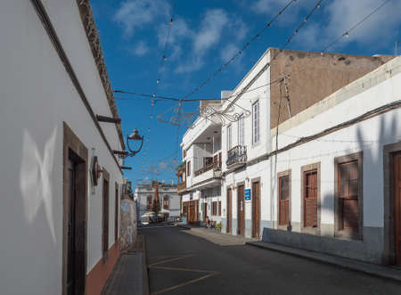 Agaete, Gran Canaria, Canary Islands, Spain December 17, 2020: Street in Agaete city center with traditional architecture, old white houses in colonial style