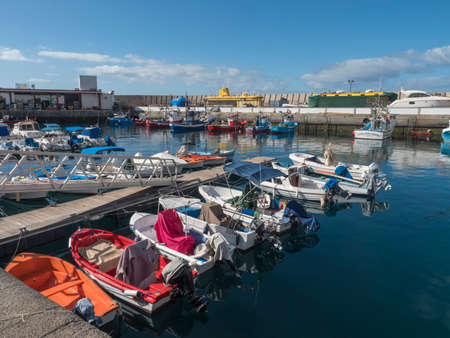 Puerto de Mogan, Gran Canaria, Canary Islands, Spain December 18, 2020: Marina with fishing boats and ships at small village port Puerto de Mogan, favorite tourist place.