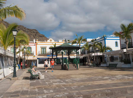 Puerto de Mogan, Gran Canaria, Canary Islands, Spain December 18, 2020: Main square and colorful buildings of small fishing village port, favorite tourist place.