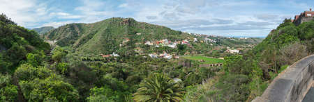 Panoramic view over green hill and valley of botanical garden, Jardin Botanico Canario Viera y Clavijo, Tafira, Gran Canaria, Canary Islands, Spain