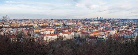 Aerial panorama view of Prague city centre cityscape and skyline with many historic and modern buildings and Vltava river, view from top of Petrin Hill. Czech Republic, winter day Imagens