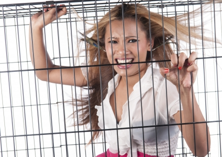 Blonde asian girl in a cage Stock Photo - 19691832