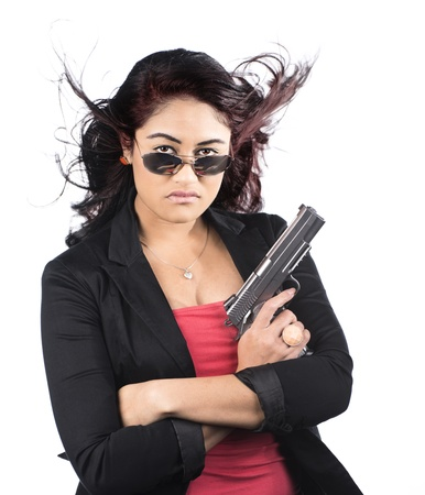 A Polynesian girl with a gun against a white background photo