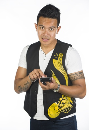 A Polynesian guy against a white background with a calculator Stock Photo