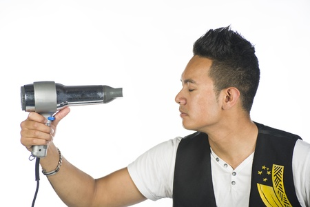 A Polynesian guy against a white background with a hair dryer