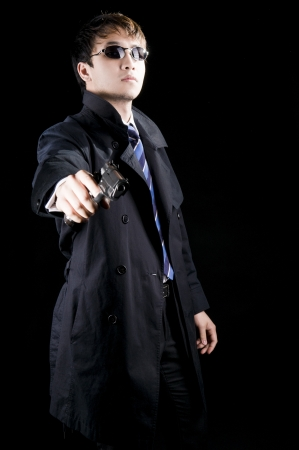An image of an Asian businessman with a blue tie against a black background photo