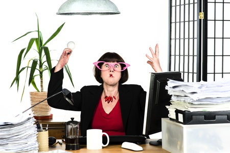 An image of a mature office worker behind her desk Stock Photo - 22114621