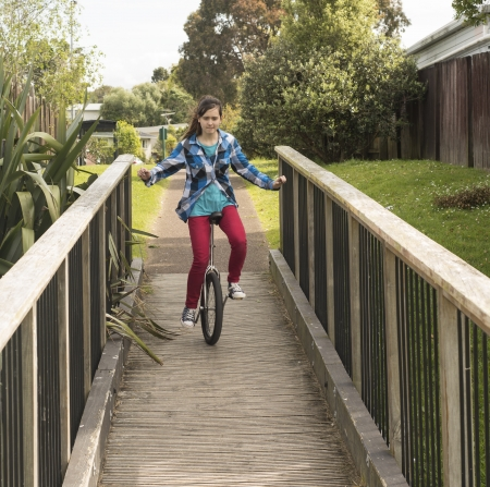 An image of a girl on a unicycle Stock Photo