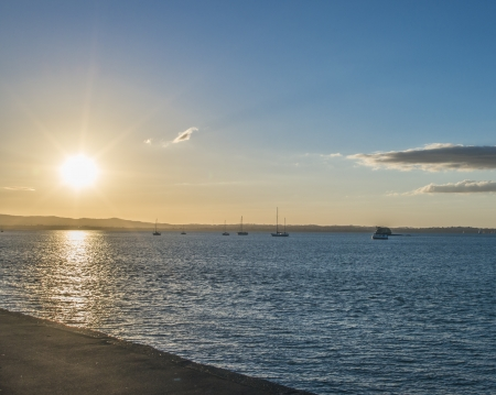 A sunset image of the Auckland harbour Stock Photo