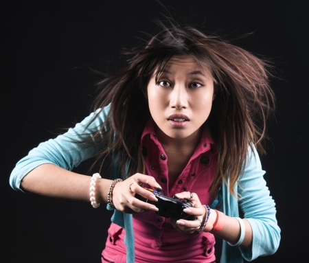 An image of an Asian girl in the studio against a black background