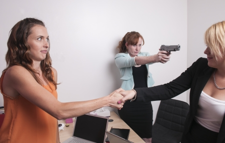 An image of three women in a business meeting photo