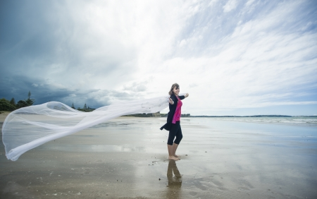 An image of a young Caucasian girl outdoor at the beach Stock Photo