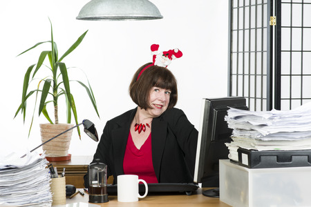 An image of a mature office worker behind her desk Stock Photo - 24605195