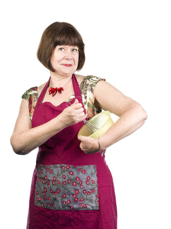An image of a mature woman with an apron