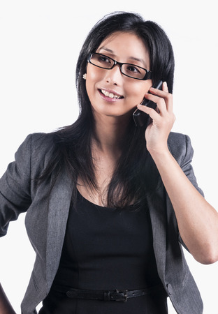 Asian business woman with mobile phone photo